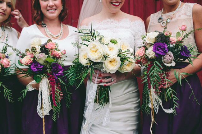 bridesmaids in purple skirts
