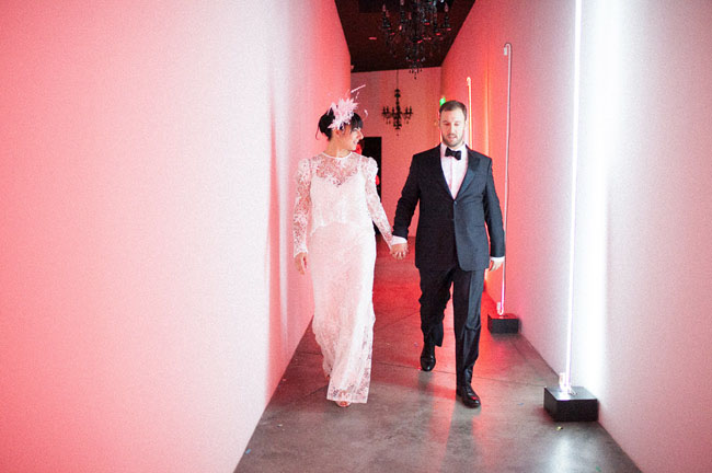 bride and groom neon hallway