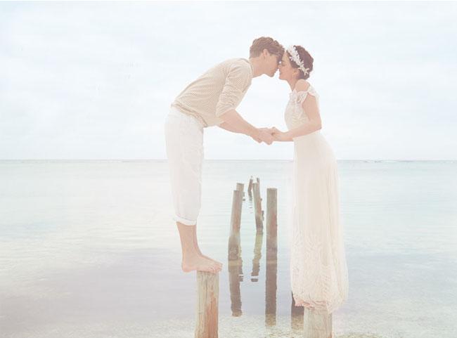 bride and groom on lake