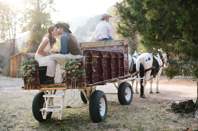 bride and groom wagon ride
