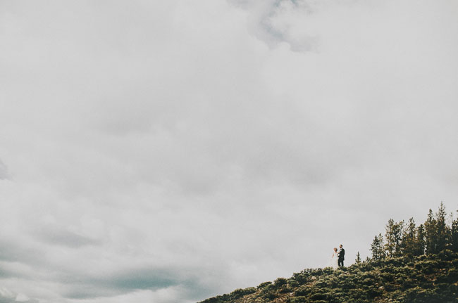 bride and groom on mountaintop