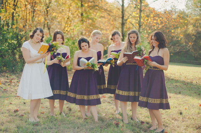 purple bridesmaids with books