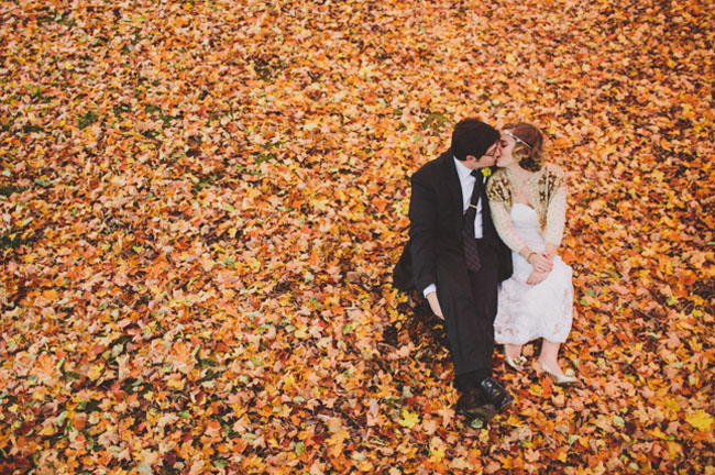 bride and groom in leaves