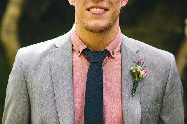pink shirt on groom