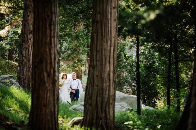 bride walking through woods