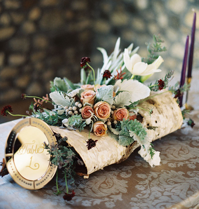 flower centerpieces in logs