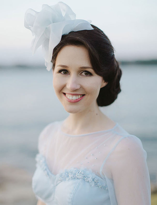 bride with blue dress and fascinator