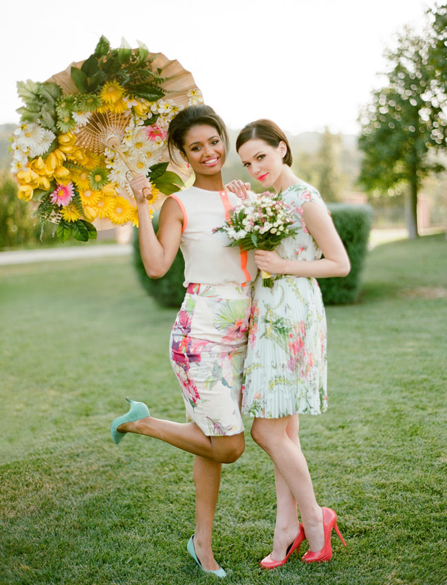 bridesmaids with flower parisol