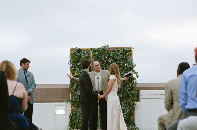 green ceremony backdrop