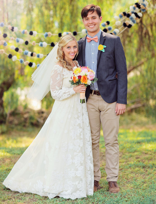 bride and groom with pom pom garland