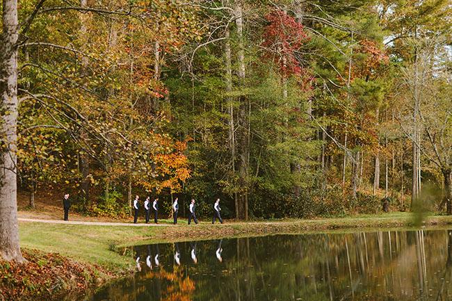 groomsmen walking by lake