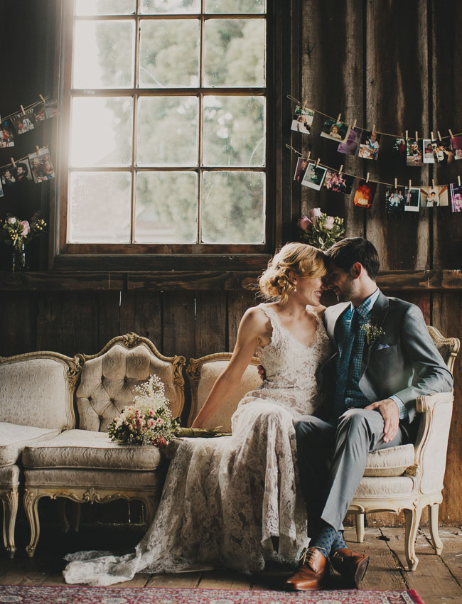 bride and groom on vintage settee