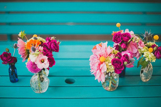 pink flowers in jars