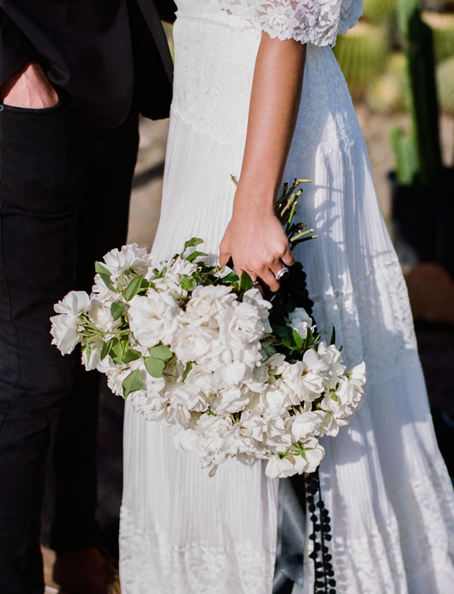 white bouquet wrapped in black ribbon