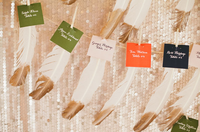 gold dipped feather escort card display