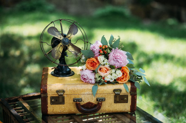 bouquet on suitcases