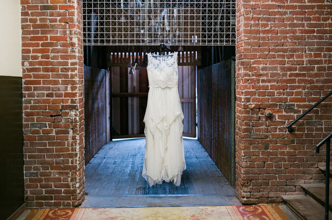 dress hanging on brick