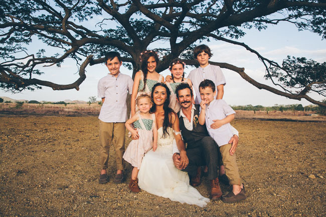 bride and groom with little ones