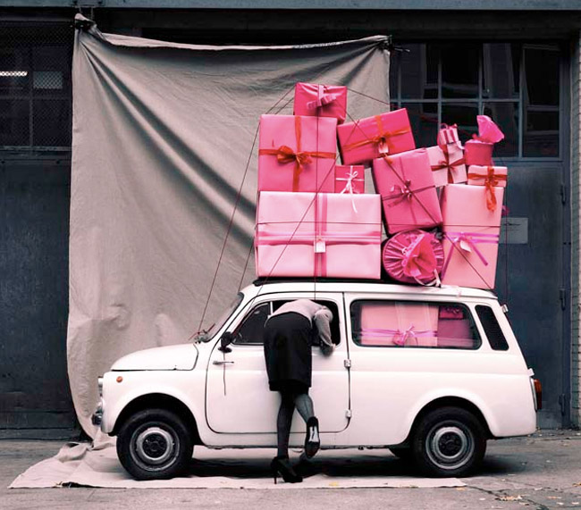 Vintage car with pink presents on top