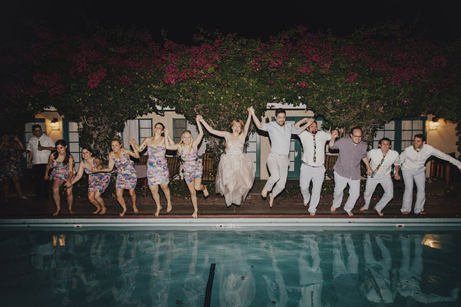 wedding party jumping in pool
