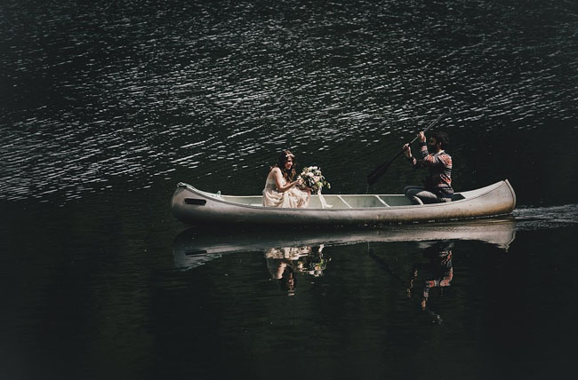 bride riding in on canoe