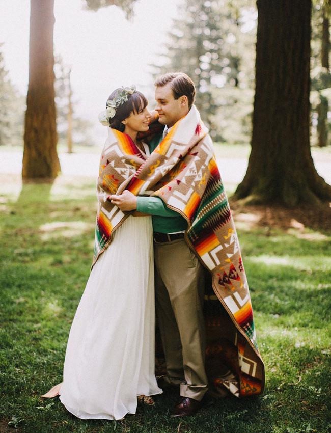 bride and groom wrapped in blanket