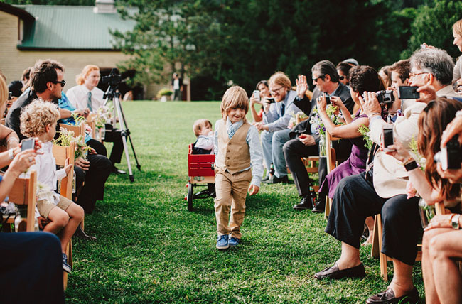 ring bearer pulling a tiny ring bearer in wagon