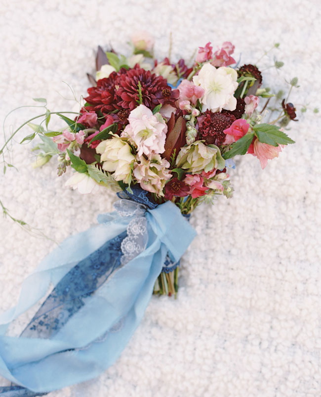 berry and indigo wrapped bouquet