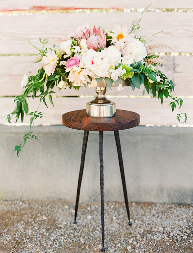 whimsical loose protea centerpiece