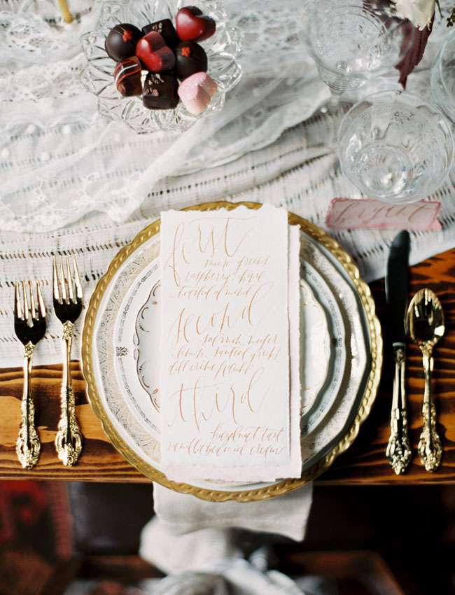 gold flatware and calligraphy menu