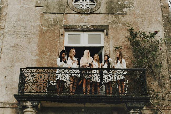 bridesmaids on balcony