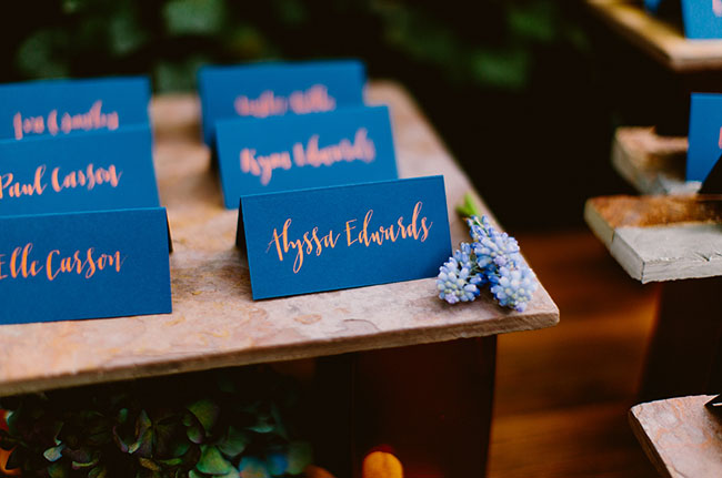 blue and orange calligraphy name cards