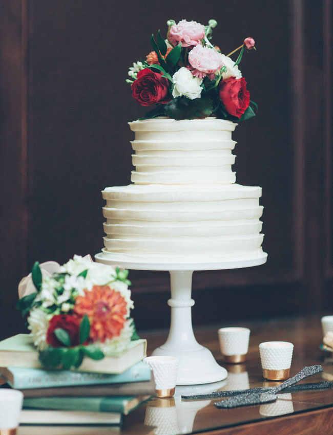 white cake with flower topper