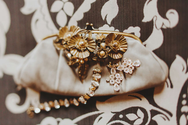 gold jewels and clutch