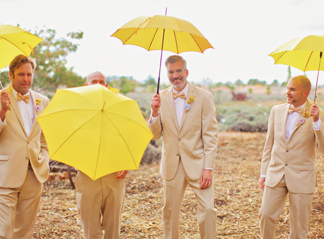 groomsmen with yellow umbrellas