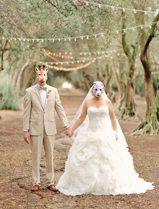 bride and groom with animal mask