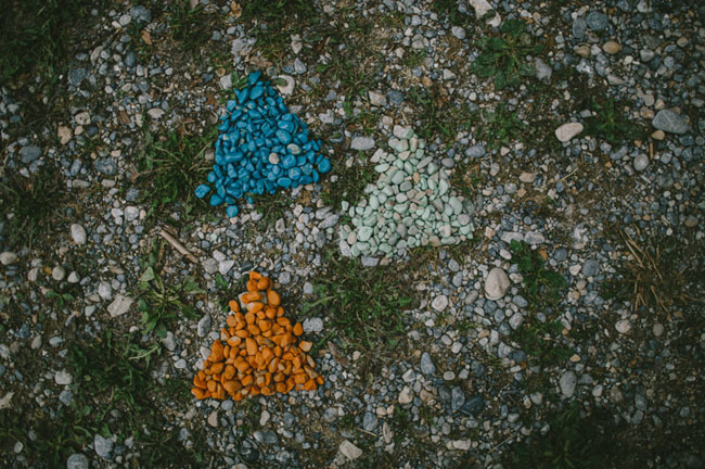colored stones as arrows