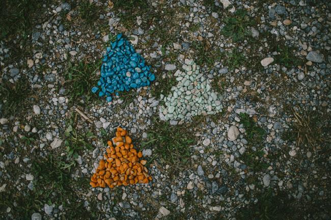 colored stones as arrows