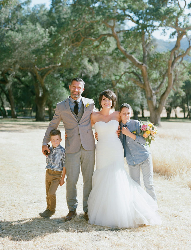 bride and groom with boys