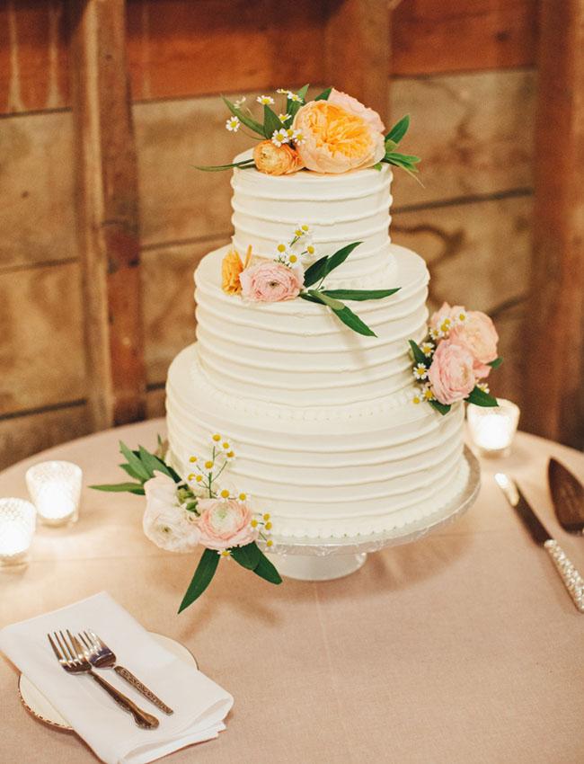ranunculus adorned cake