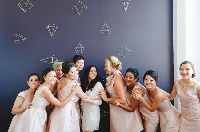 bridesmaids and geo backdrop