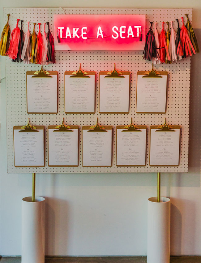 neon sign and clipboard seating chart