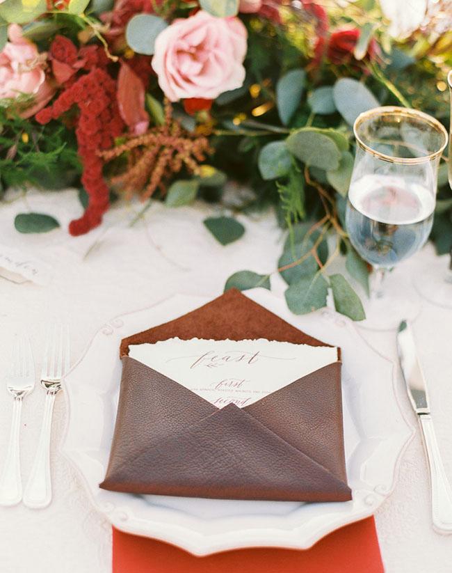 red leather menu holder
