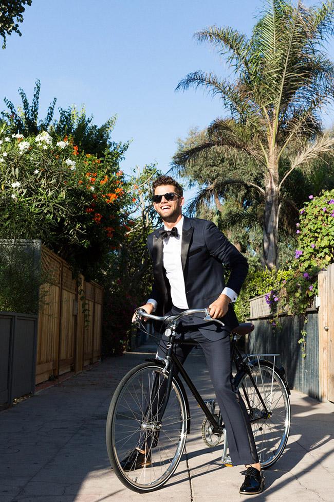 groom in a tux on a bike