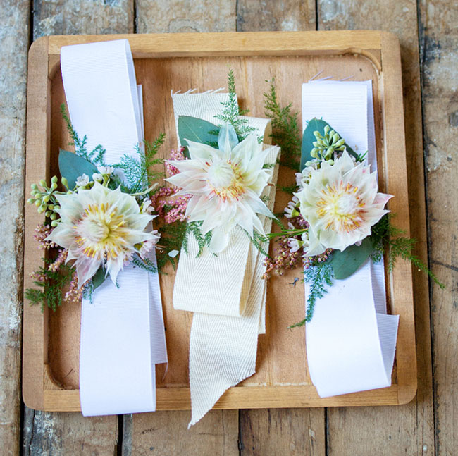 blushing protea corsages