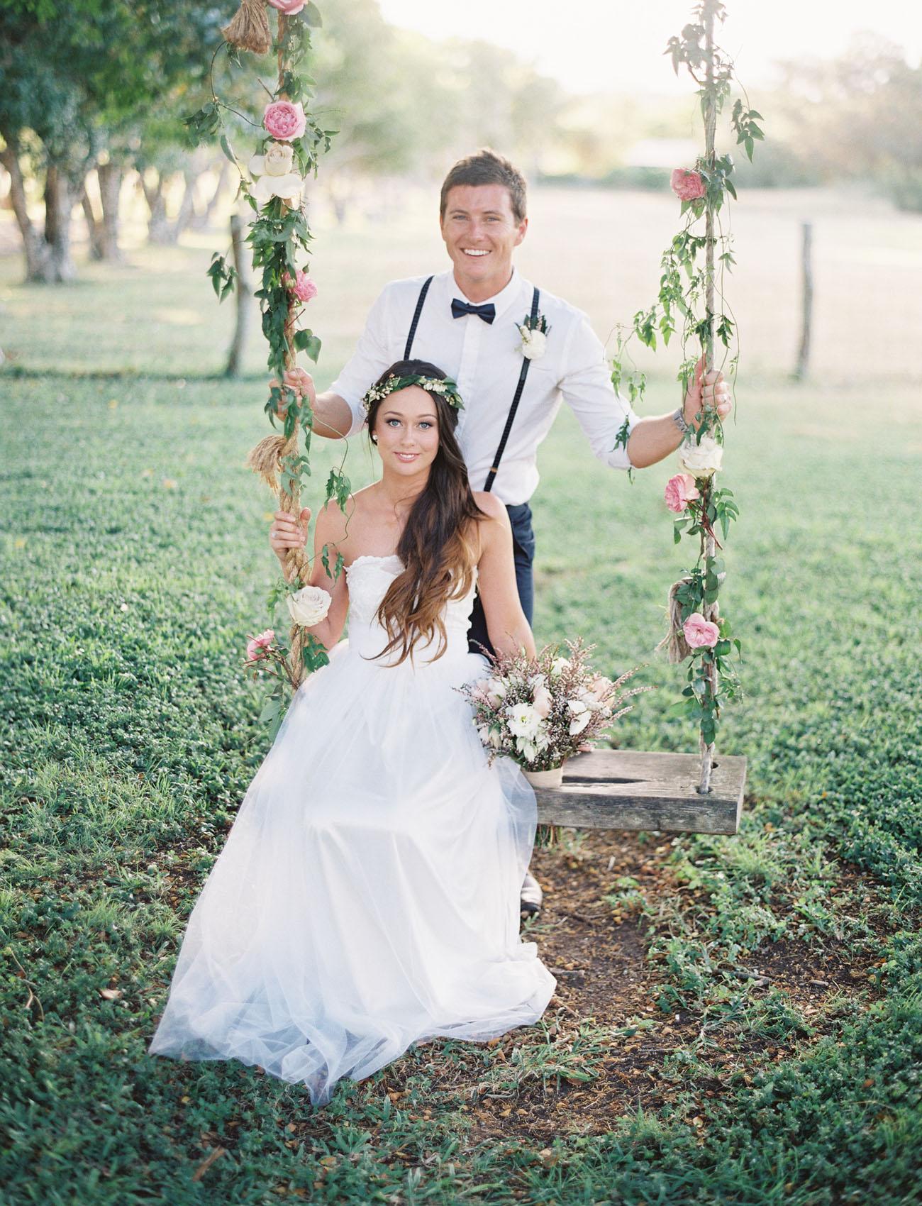 Romantic hawaiian wedding at puakea ranch alexis ben green hawaii ranch wedding flower swing junglespirit Images