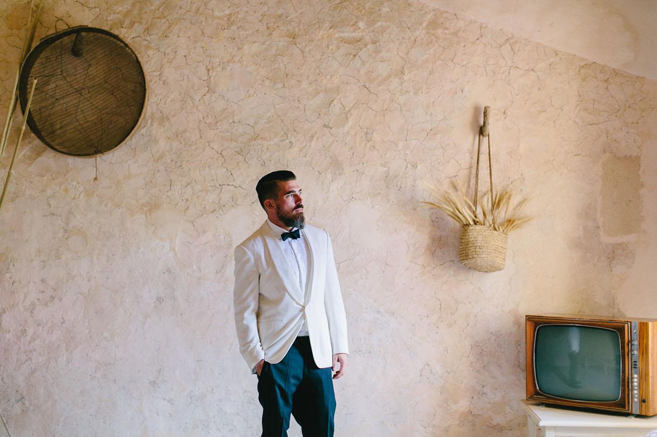 white suit groom