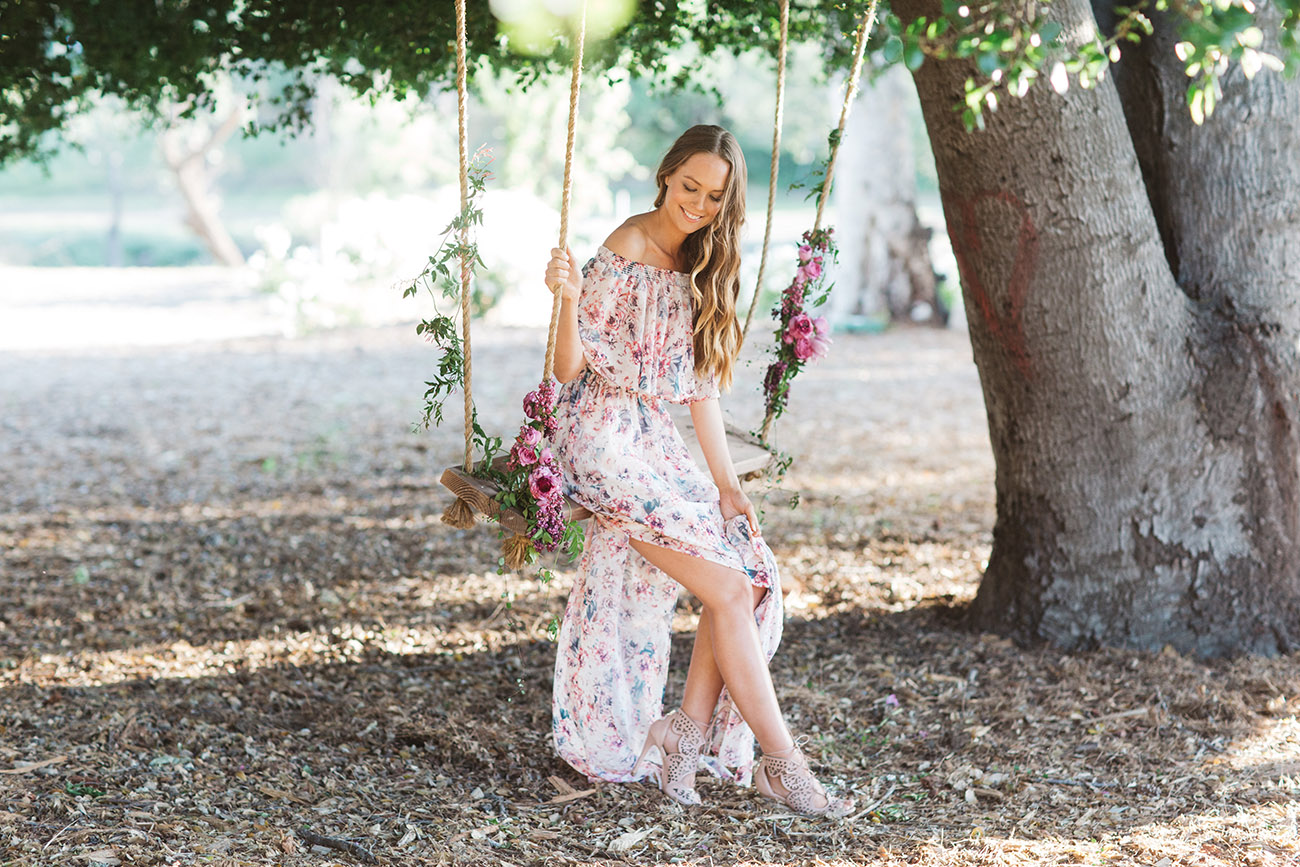 Green Wedding Shoes X Mumu Bridesmaid dress on a swing