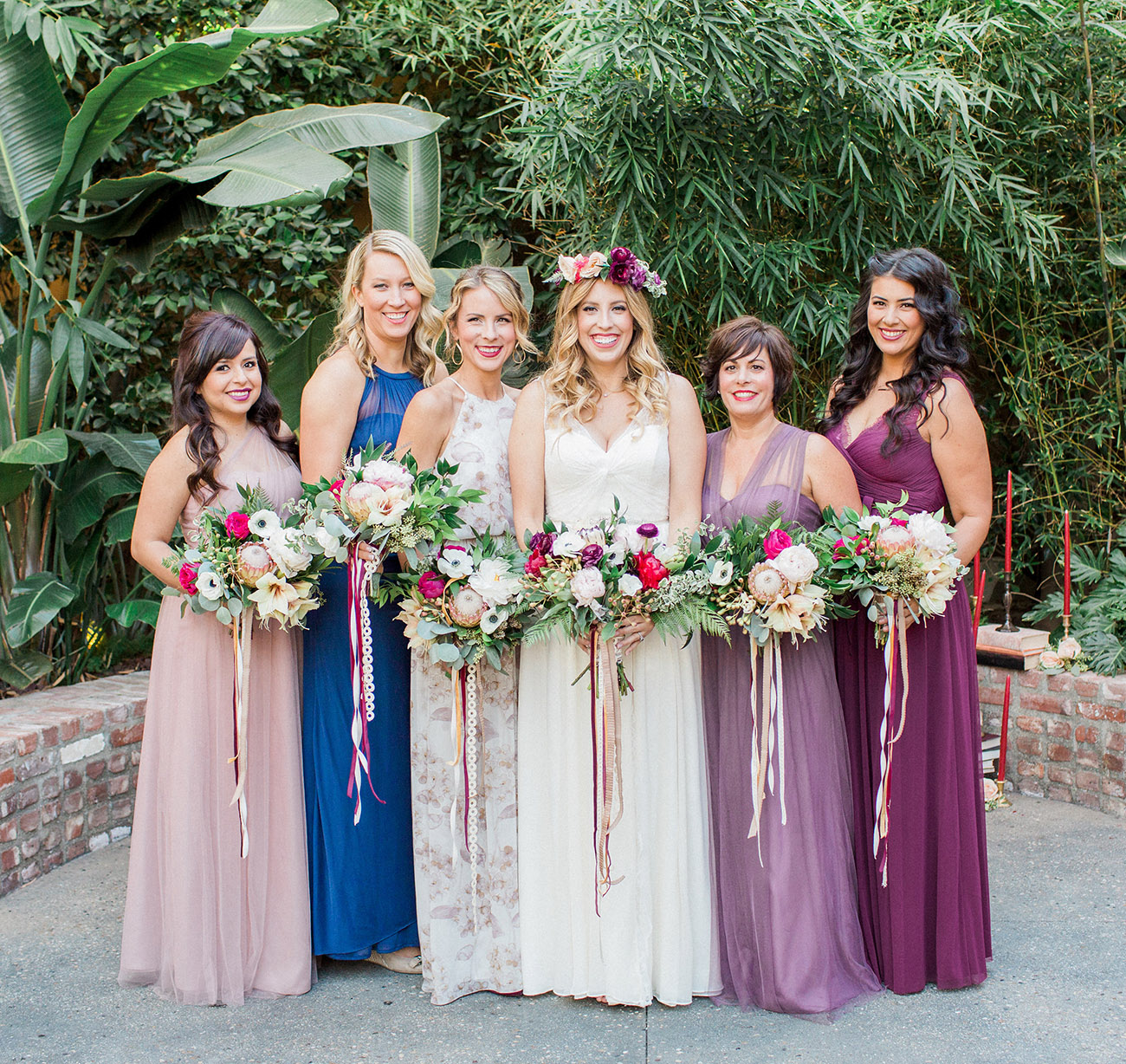 bridesmaids in jewel toned dresses