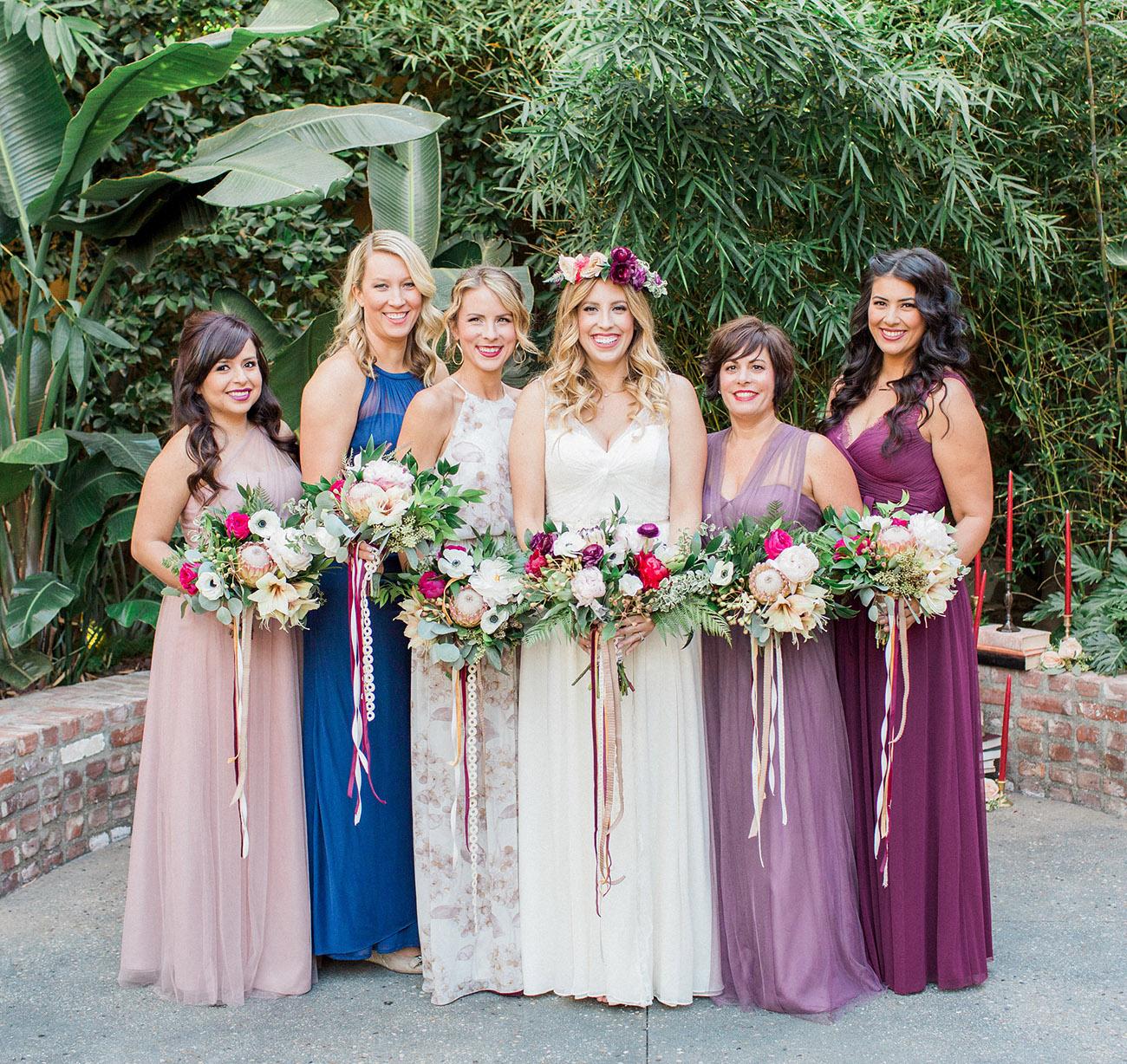 bridesmaids in jewel toned dresses